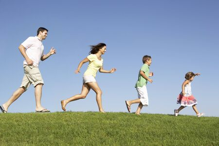 chasing: Young family, parents with children,  running through field