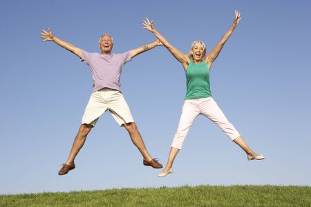 Senior couple jumping in air Stock Photo - 8503622