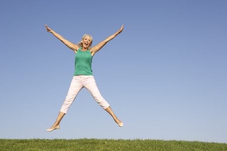 Senior woman  jumping in air Stock Photo - 8503579