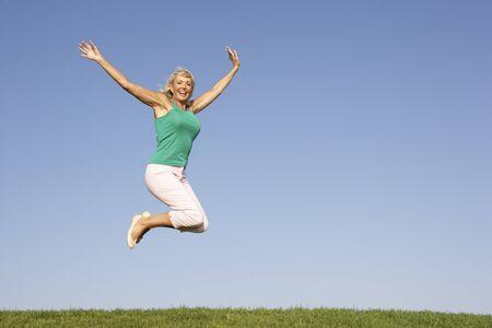 Senior woman  jumping in air Stock Photo - 8503567