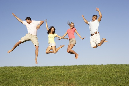 Young couples jumping in air photo