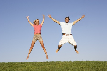full length woman: Young couple jumping in air