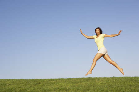 Young woman  jumping in air photo