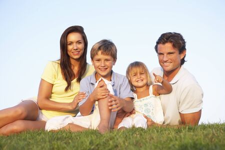 each year: Young parents, with children, posing on a field Stock Photo