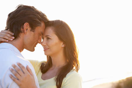 Romantic Young couple in love at sunset photo