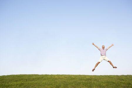 active retirement: Senior man jumping in air