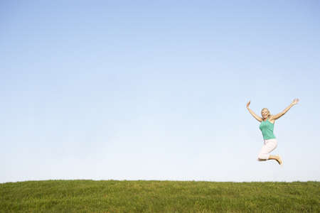Senior woman  jumping in air Stock Photo - 8503597