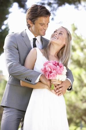 bridal couple: Portrait Of Bridal Couple Outdoors
