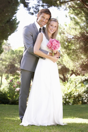 Portrait Of Bridal Couple Outdoors photo