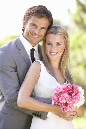 Portrait Of Bridal Couple Outdoors Stock Photo