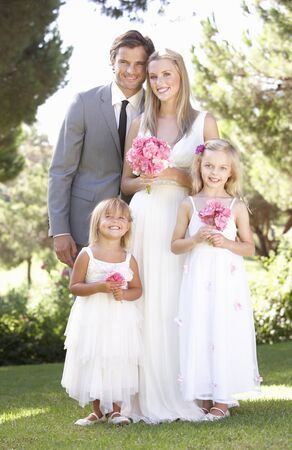 Bride And Groom With Bridesmaid At Wedding Stock Photo - 8503640