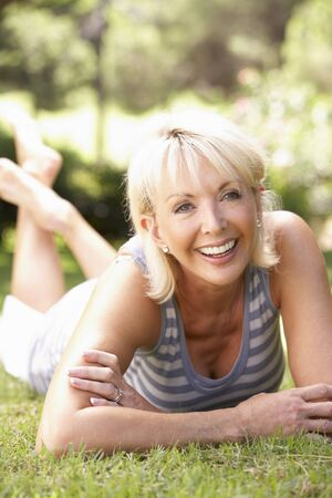 Middle age woman posing in park photo