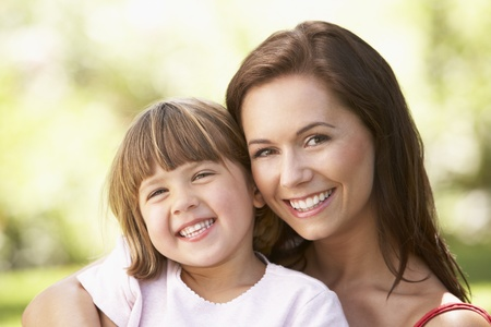 Portrait Of Mother And Child Relaxing In Park photo