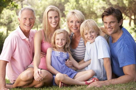 A family, with parents, children and grandparents, relaxing in a park Stock Photo - 8514461