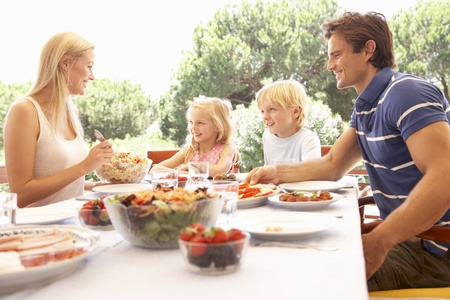 Parents, with children, enjoy a picnic photo