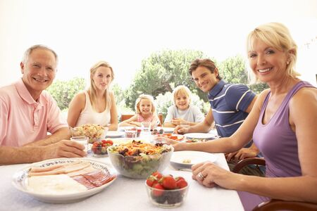 Extended family, parents, grandparents and children, eating outdoors Stock Photo - 8505094