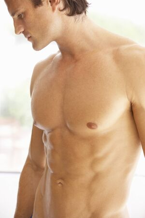 six pack: Portrait Of Muscular Torso Of Young Man