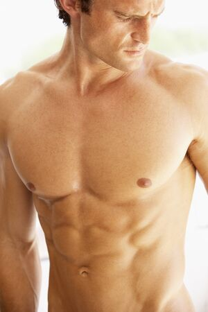 six pack abs: Portrait Of Bare Muscular Torso Of Young Man
