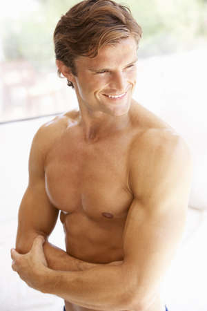 Portrait Of Muscular Torso Of Young Man photo