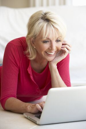 imagining: Middle age woman on her laptop computer