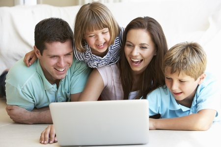 computer: Young parents, with children, on laptop computer