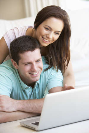 Young couple on laptop computer photo