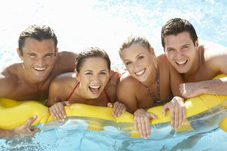 Group of Young friends having fun in pool photo