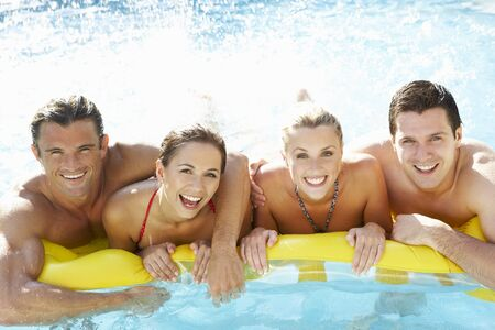 friends laughing: Group of Young friends having fun in pool