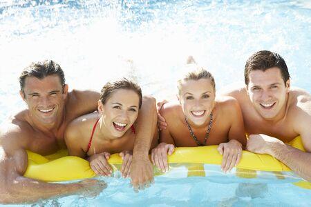 friends having fun: Group of Young friends having fun in pool