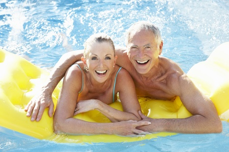 having fun: Senior couple having fun in pool