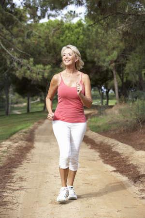 Senior woman running in park Stock Photo - 8510208