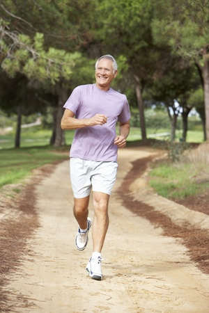 healthy seniors: Senior man running in park