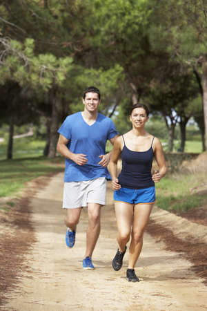 Couple running in park photo