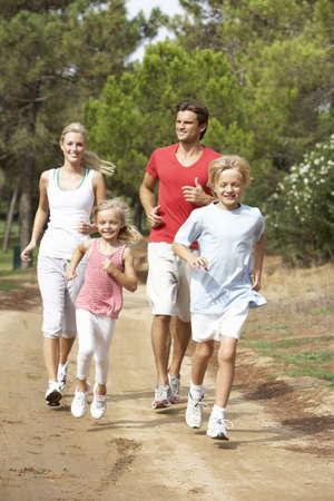 Family running in park Stock Photo - 8505192