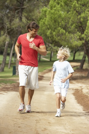 father and son: Father and son running in park