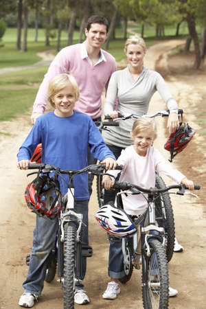 Family enjoying bike ride in park Stock Photo - 8505197