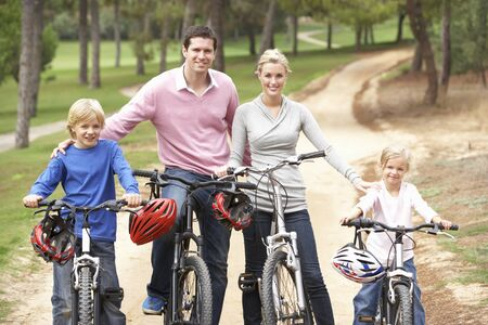 Family enjoying bike ride in park Stock Photo - 8514462