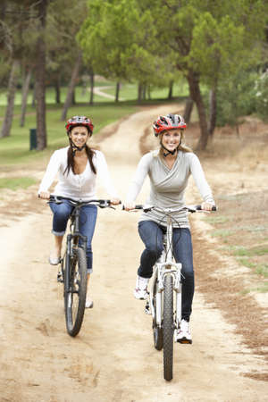 Couple riding bicycle in park Stock Photo - 8505185