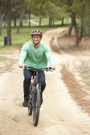 Man riding bicycle in park Stock Photo - 8510229