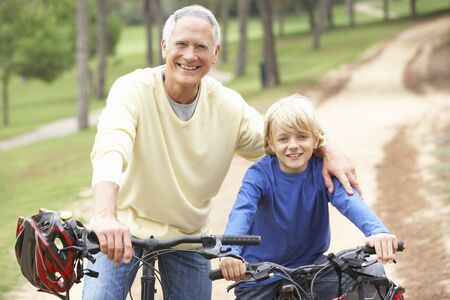 Grandfather and grandson riding bicycle in park Stock Photo - 9174776