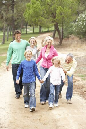 Three Generation Family enjoying walk in park photo