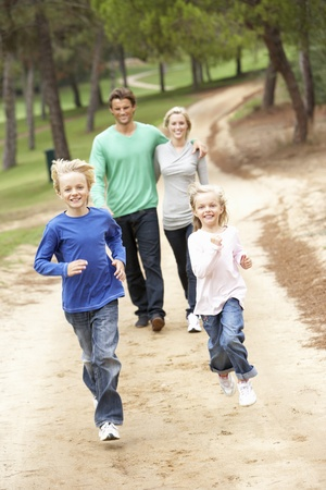 old people walking: Family enjoying walk in park Stock Photo
