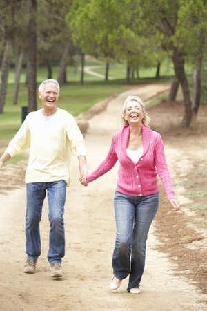 walk in: Senior Couple enjoying walk in park