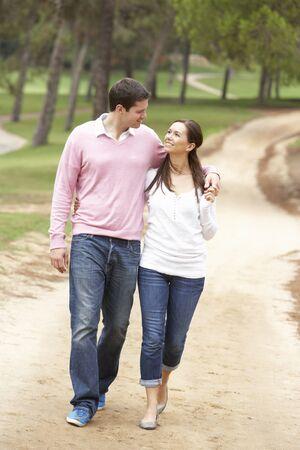 couple talking: Romantic couple enjoying walk in park Stock Photo
