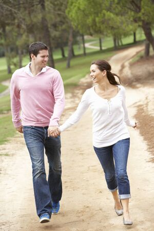 Couple having fun in park Stock Photo - 9174780