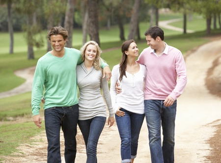 Group of friends enjoying walk in park photo