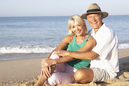 Senior couple sitting on beach relaxing Stock Photo - 9197340