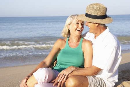 Senior couple sitting on beach relaxing Stock Photo - 9197362