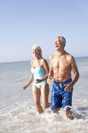 Senior couple on beach holiday photo