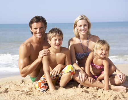 5 10 year old girl: Young family pose on beach